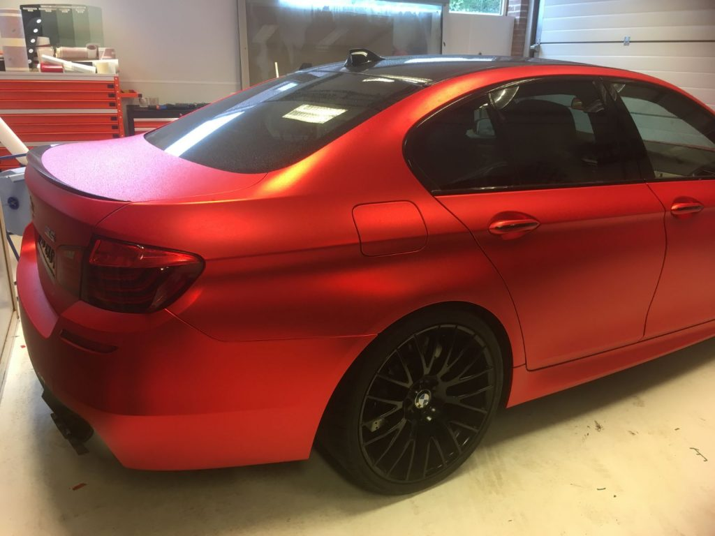 BMW M5 Inferno Red mat chrome wrap