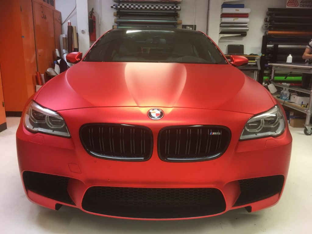 BMW M5 Inferno red chrome wrap